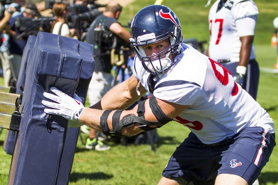 Day 16: August 19   Defensive end J.J. Watt (99) hits a blocking sled during a joint practice with the Denver Broncos at the Broncos training facility on Tuesday in Englewood, Colo. Photo: Brett Coomer, Houston Chronicle