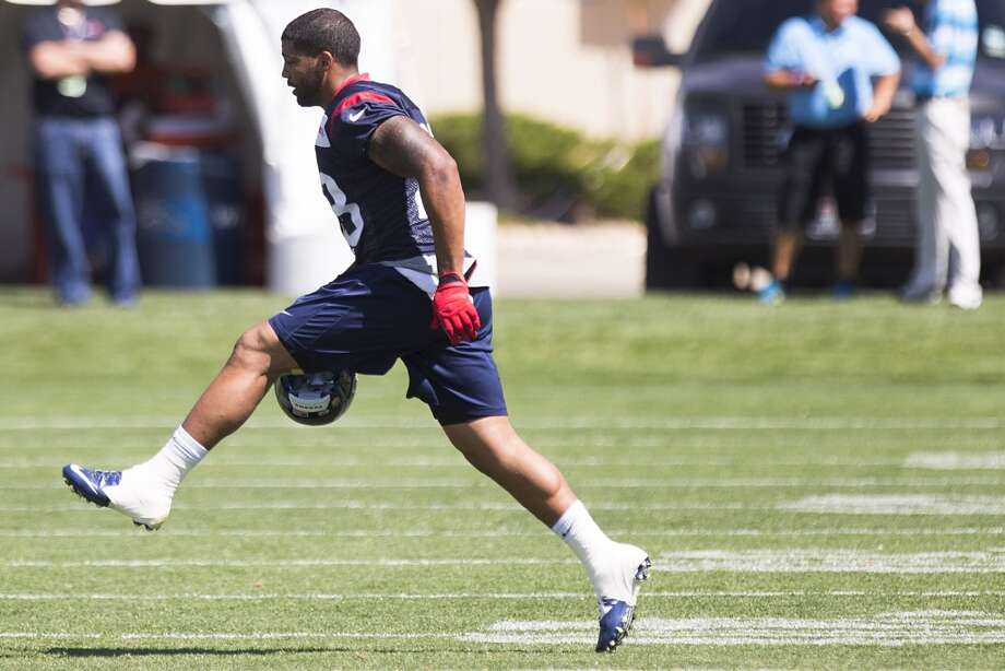 Texans running back Arian Foster (23) runs across the field. Photo: Brett Coomer, Houston Chronicle
