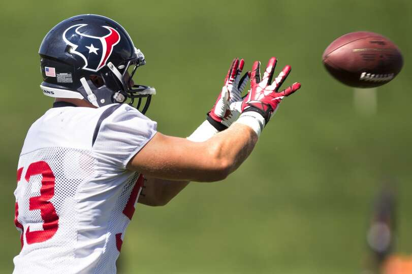 Texans inside linebacker Max Bullough (53) reaches out to catch a ball.
