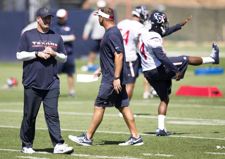 Texans head coach Bill O'Brien walks across the practice field.
