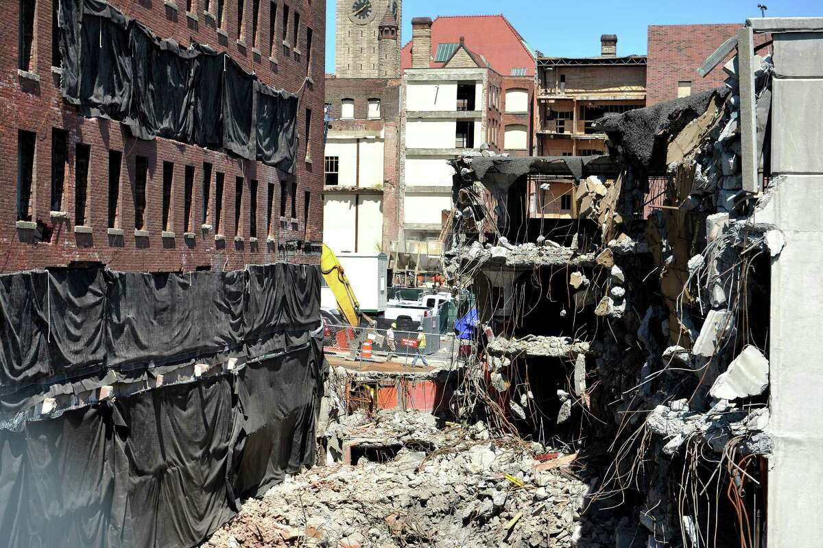 A view of the former Wellington Hotel Annex and a parking garage next to it, as workers continue preparation for the implosion of the building on Tuesday, Aug. 19, 2014, in downtown Albany, N.Y. (Paul Buckowski / Times Union)