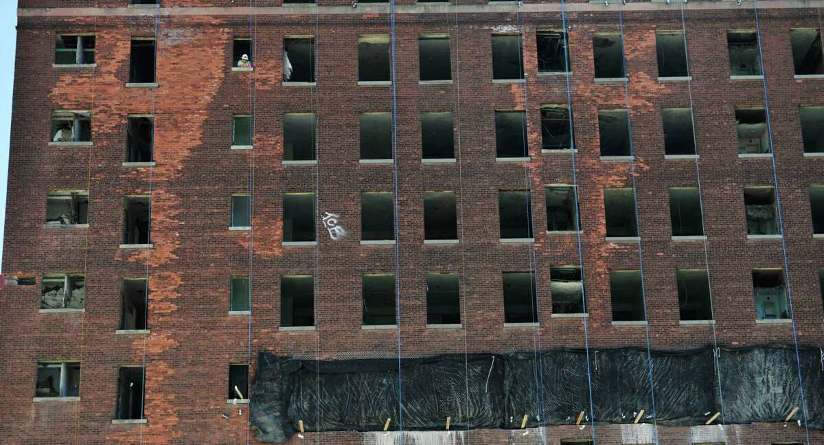 A worker is seen in an upper floor of the Wellington Hotel Annex as workers continue preparation for the implosion of the building on Tuesday, Aug. 19, 2014, in downtown Albany, N.Y. (Paul Buckowski / Times Union)
