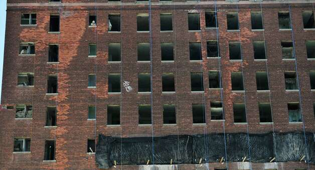 A worker is seen in an upper floor of the Wellington Hotel Annex as workers continue preparation for the implosion of the building on Tuesday, Aug. 19, 2014, in downtown Albany, N.Y.   (Paul Buckowski / Times Union) Photo: Paul Buckowski / 00028232A