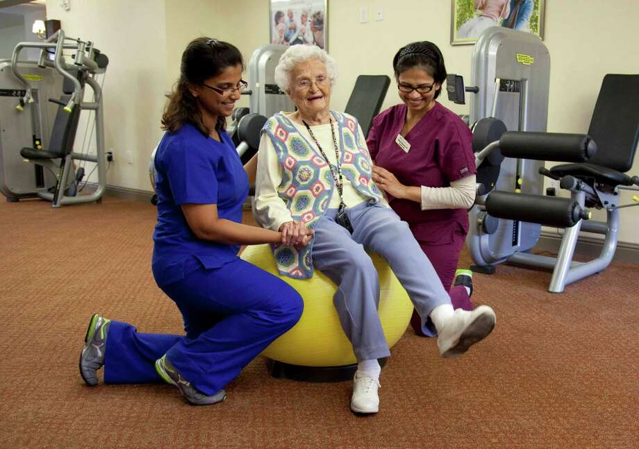 "Parkway Place physical therapists Neha Nayak (left) and Pallavi Sharma (right) put their ""therapeutic modalities"" to use to assist residents such as Shirley Clark during exercise sessions."
