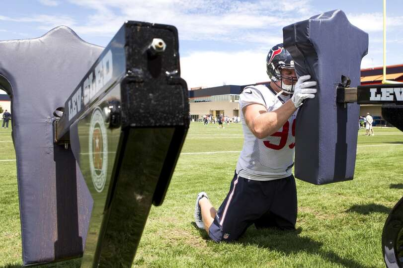 Texans defensive end J.J. Watt hits a blocking sled.