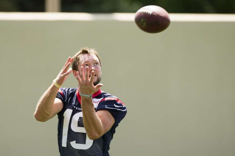 Texans wide receiver Travis Labhart reaches up to catch a pass following a joint practice.