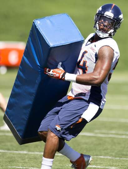 Broncos linebacker Brandon Marshall (54) hits a blocking dummy.