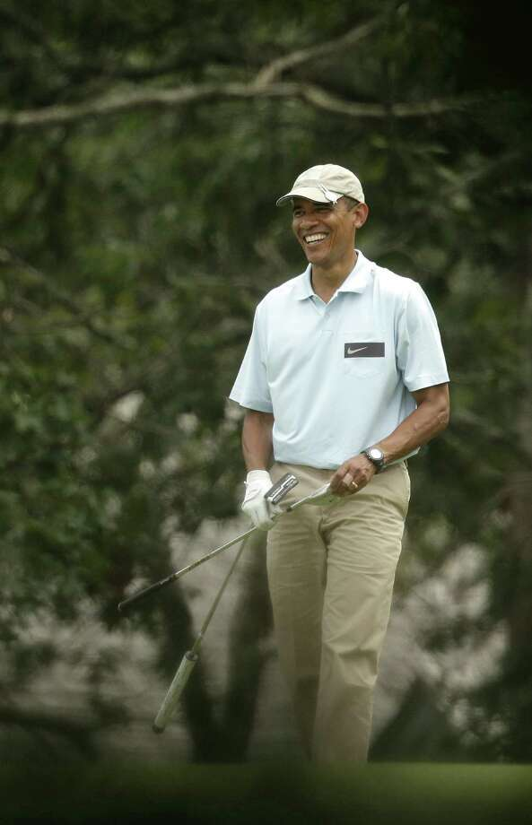 President Barack Obama enjoys a round of golf  at Martha's Vineyard, Mass. As crises engulf the globe, a reader calls the president an absentee landlord of the White House whose chief function is fundraising. Photo: Steven Senne / Associated Press / AP