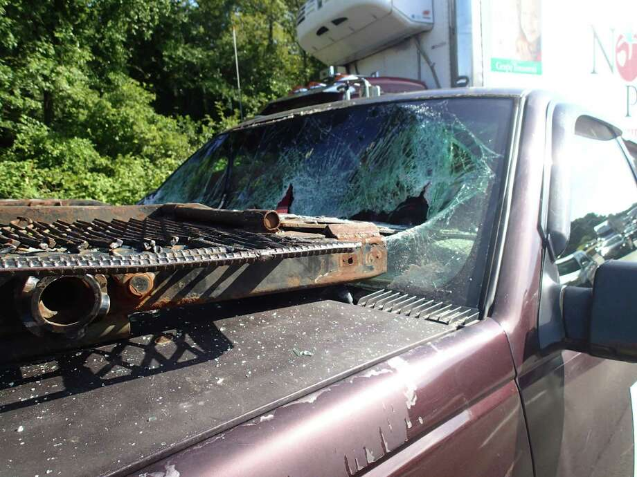 A collision between a vehicle transporter, a box truck and a large SUV on Interstate 95 Tuesday morning caused serious damage to the vehicles involved. Photo: Westport Fire Department / Westport News