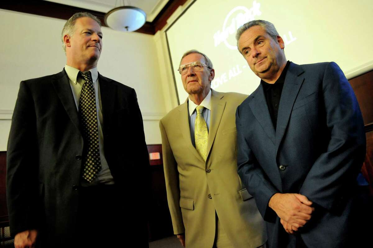 John Signor, OTB president and CEO, left, Mayor Dan Dwyer, center, and Jim Allen, chairman of Hard Rock International, stand together following the presentation of the Hard Rock Hotel and Casino proposal on Thursday, June 19, 2014, in Rensselaer, N.Y. (Cindy Schultz / Times Union)