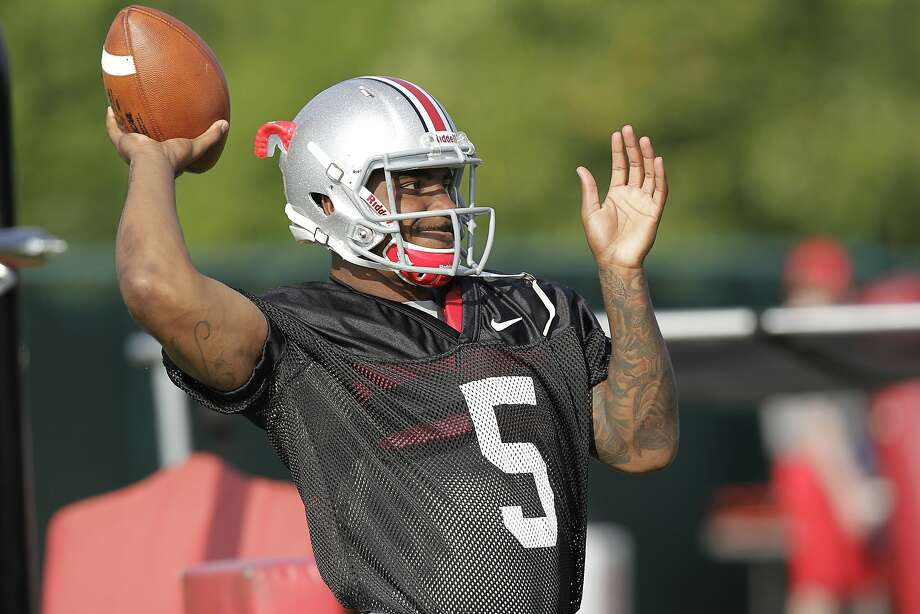 Ohio State's Braxton Miller warms up during a practice Aug. 9 in Columbus. He was injured in the Orange Bowl on Jan. 3. Photo: Jay LaPrete, Associated Press