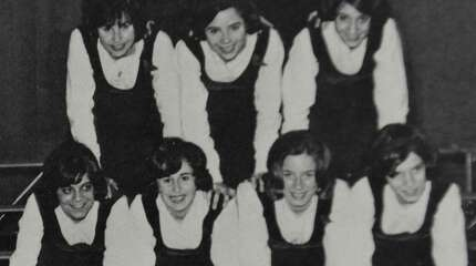 Pat Schultz, bottom left, and Donna Gillotte, to her right, pose at the bottom of the cheerleaders' pyramid in the Danbury High School 1964 yearbook, photographed Tuesday, Aug. 19, 2014.