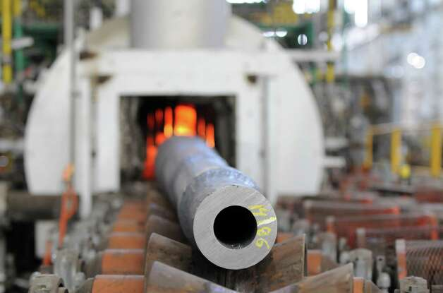 A 120 mm smoothbore gun barrel used on an Abrams tank is slowly inserted into a heat treatment unit before being machined Tuesday, Aug. 19, 2014, at the Watervliet Arsenal in Watervliet, N.Y. The barrels are annealed through a multi-stage heating and cooling process. (Will Waldron/Times Union) Photo: WW