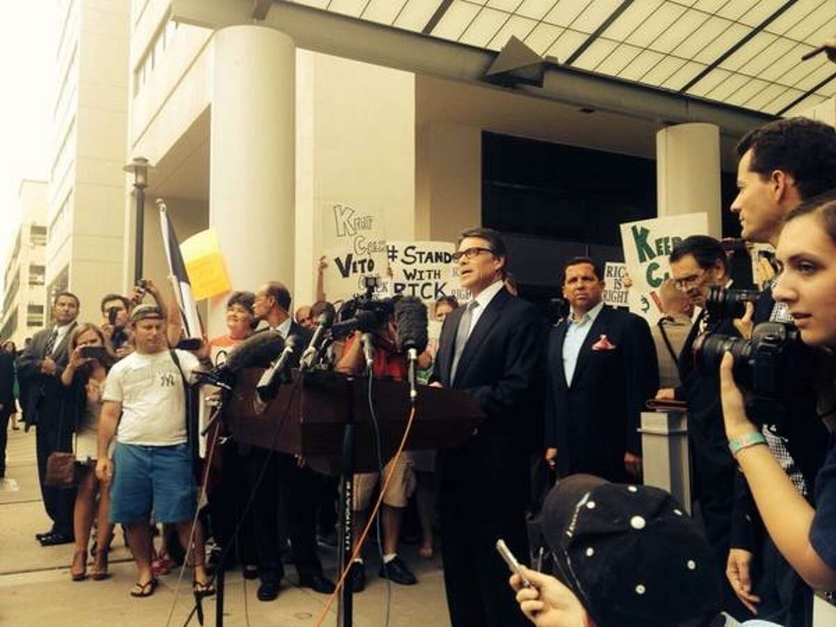 Rick Perry address the media and supporters at the Travis County Courthouse, where he turned himself in following a felony indictment for abuse of power. (Photo via twitter.com/davidSrauf)