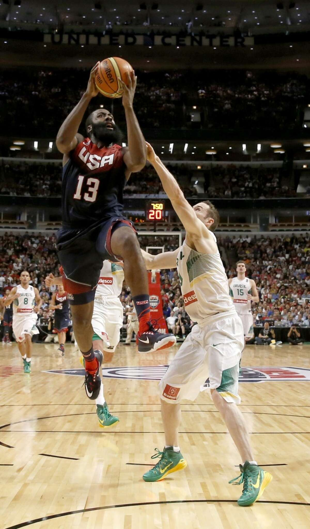 James Harden drives to the basket past Brazil's Marcelo Huertas, during the second half of an exhibition game between the U.S. and Brazilian national teams Saturday, Aug. 16, 2014, in Chicago.