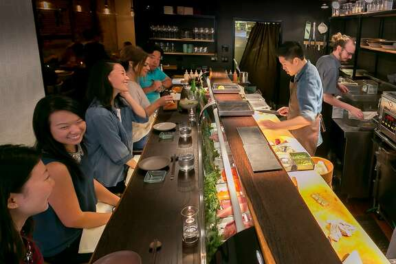 People have dinner at the sushi bar at Akiko's in San Francisco, Calif., on Saturday, September 14th, 2013.