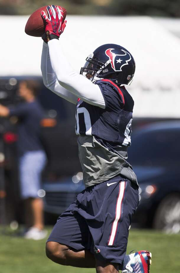 Texans wide receiver Andre Johnson reaches up to make a catch. Photo: Brett Coomer, Houston Chronicle