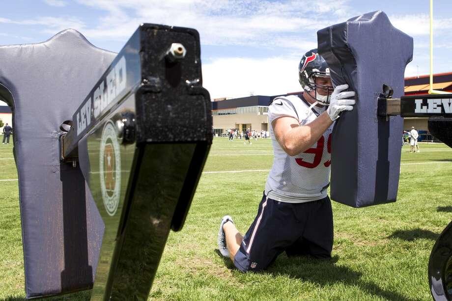 Texans defensive end J.J. Watt hits a blocking sled. Photo: Brett Coomer, Houston Chronicle