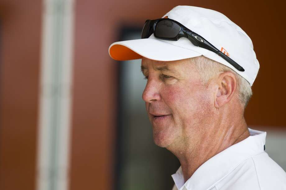 Broncos head coach John Fox speaks to the media following a joint practice. Photo: Brett Coomer, Houston Chronicle