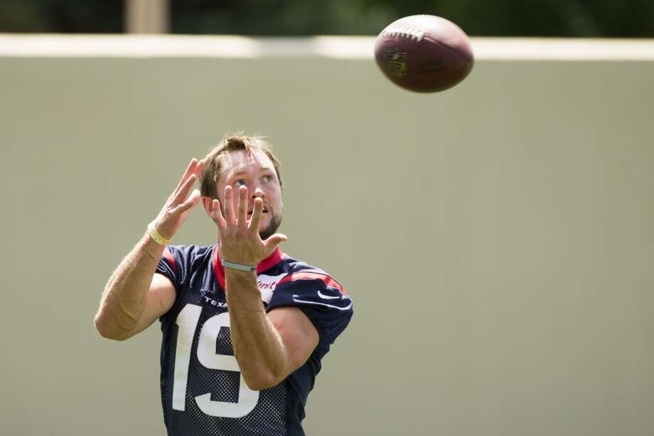 Texans wide receiver Travis Labhart reaches up to catch a pass following a joint practice. Photo: Brett Coomer, Houston Chronicle