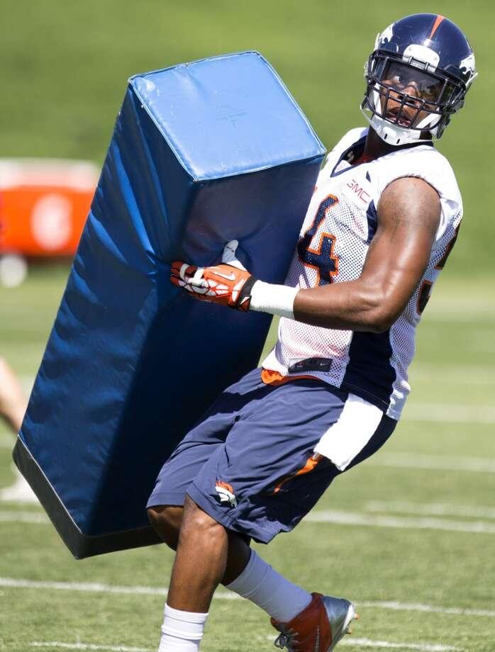 Broncos linebacker Brandon Marshall (54) hits a blocking dummy. Photo: Brett Coomer, Houston Chronicle