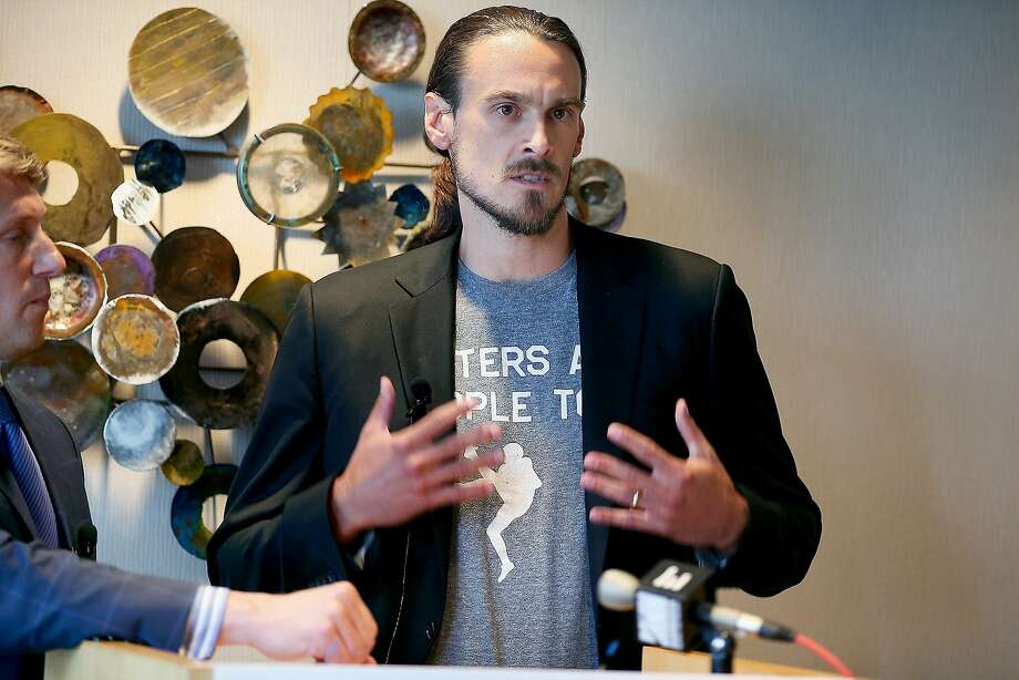 Former Vikings punter Chris Kluwe, shown speaking in July, says he was cut because of his activism on gay rights issues. Photo: Elizabeth Flores, Associated Press