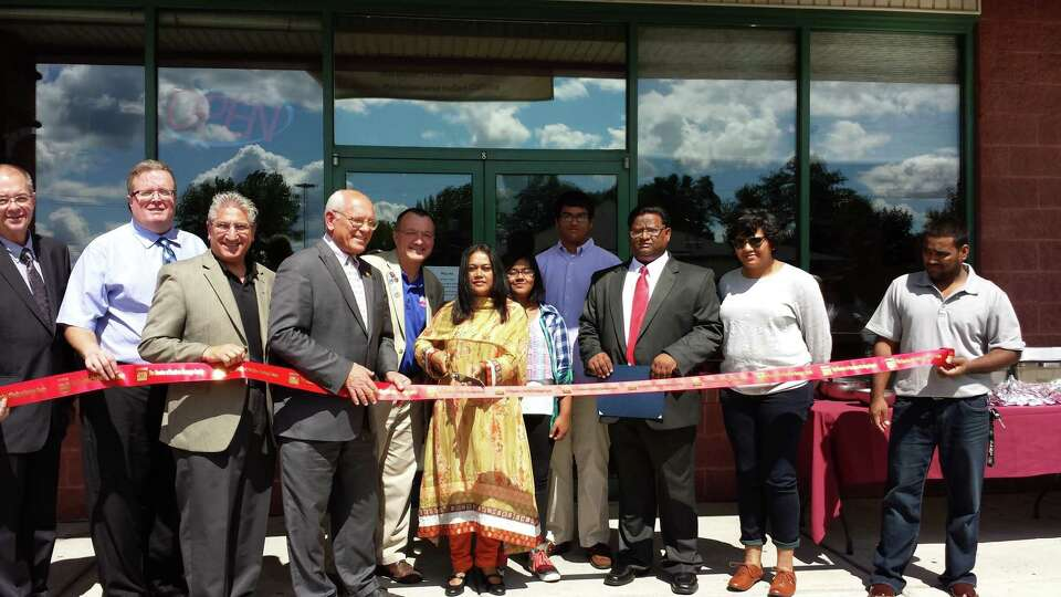 Community and business leaders join the Siddiqui family in Halfmoon for the grand opening of Kabab M