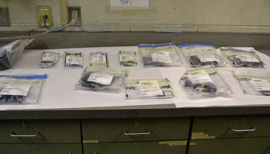Cellphones and GPS units are among the items recovered from from recent car thefts in the Beman Park neighborhoood of Troy. (Troy Police Department photo)