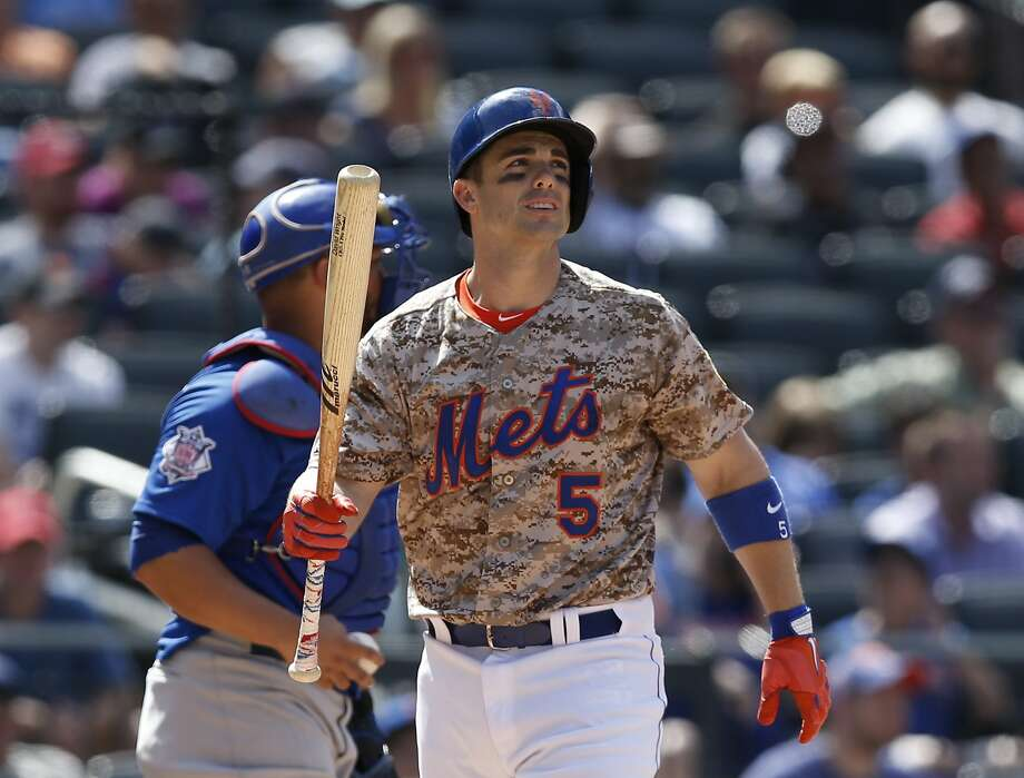 David Wright reacts after striking out in the ninth inning of the Mets' 4-1 loss to the Cubs on Monday at Citi Field in New York. Photo: Kathy Willens, Associated Press