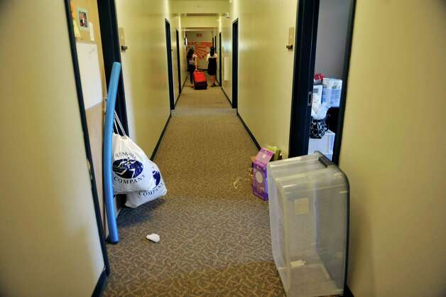 New students make their way down a hall in their dorms during freshman  move-in day at RPI, on Tuesday, Aug. 19, 2014, in Troy, N.Y.   (Paul Buckowski / Times Union) Photo: Paul Buckowski / 00028219A