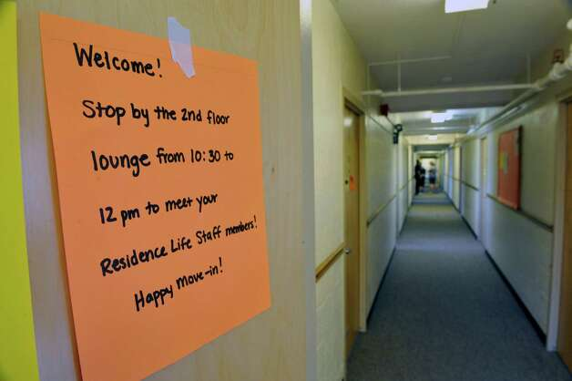 New students make their way down a hall in a dorm during freshman  move-in day at RPI, on Tuesday, Aug. 19, 2014, in Troy, N.Y. (Paul Buckowski / Times Union) Photo: Paul Buckowski / 00028219A