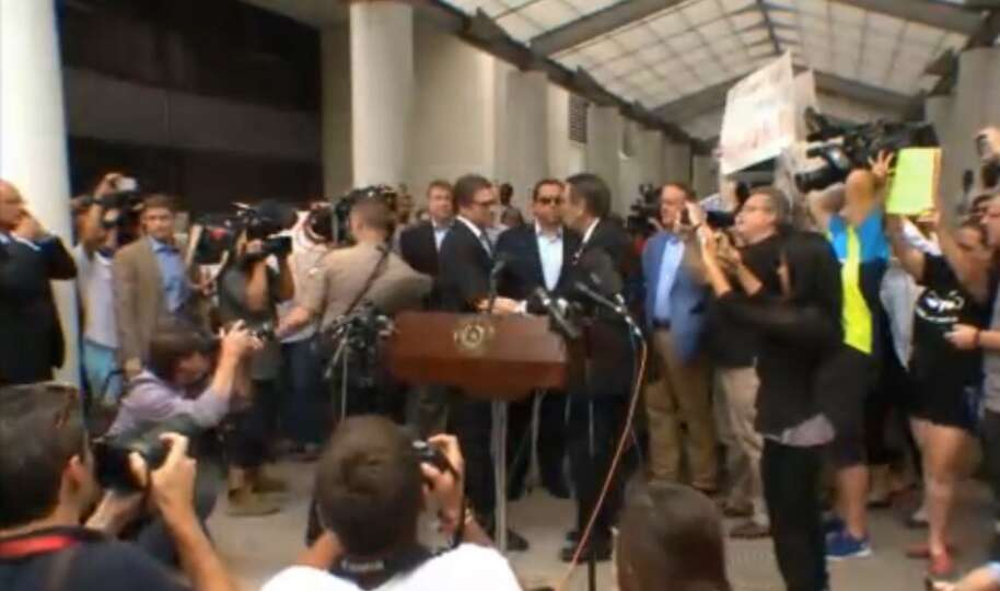 Texas Gov. Rick Perry appears prior to his Aug. 19, 2014 booking in Austin on a charge of abuse of p