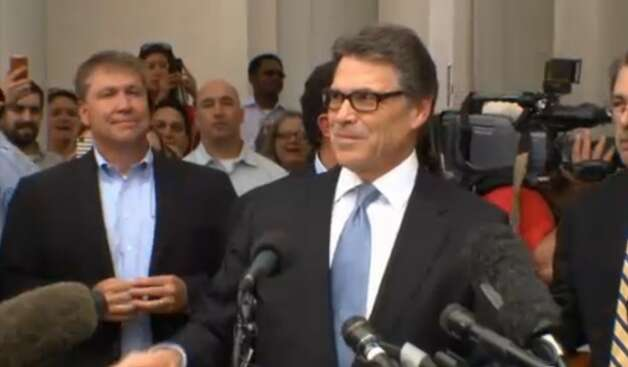 Texas Gov. Rick Perry appears prior to his Aug. 19, 2014 booking in Austin on a charge of abuse of power. | Photo still from Texas Tribune video