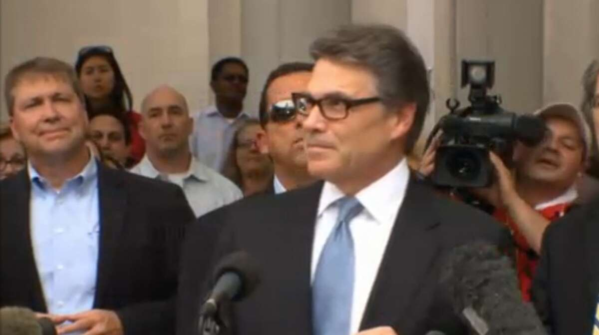 Texas Gov. Rick Perry appears prior to his Aug. 19, 2014 booking in Austin on a charge of abuse of power.   Photo still from Texas Tribune video