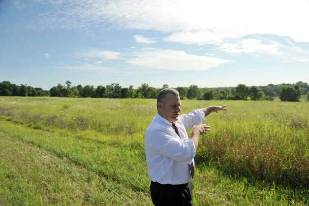 New Scotland Town Board member, Daniel Mackay, stands near the former Bender Mellon Farm land  on Tuesday, Aug. 19, 2014, in New Scotland, N.Y.  This land is where in 2009 a developer wanted to build a mall.   (Paul Buckowski / Times Union) Photo: Paul Buckowski / 00028199A