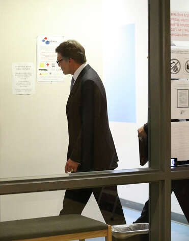 Texas Governor Rick Perry goes through the process of being booked for felony charges at the Travis County Courthouse in Austin on August 20, 2014. Photo: TOM REEL