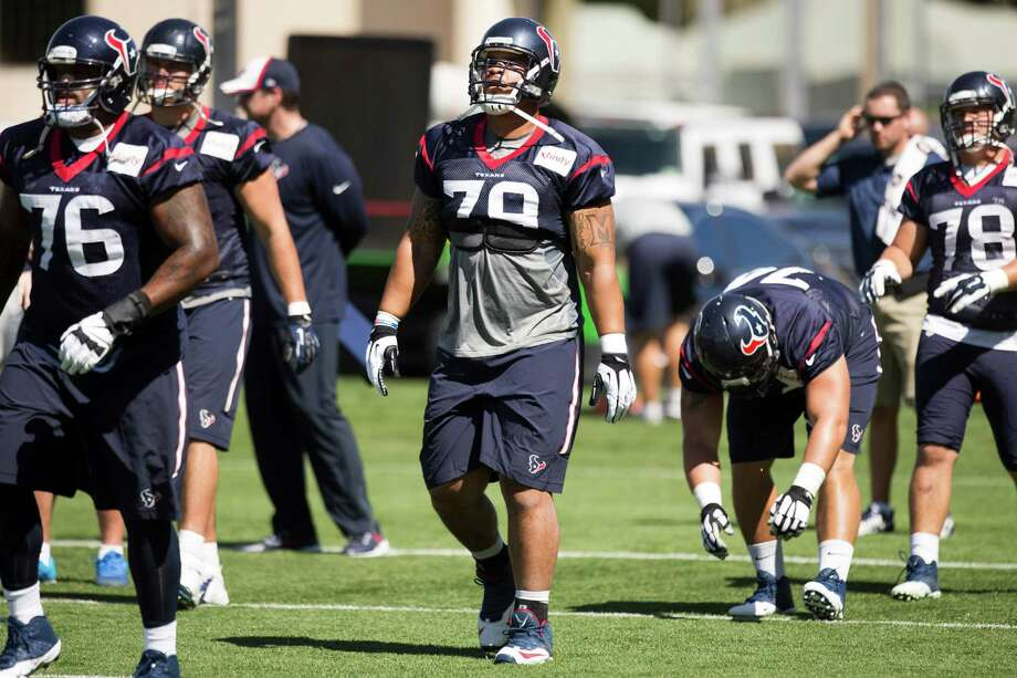 Brandon Brooks, right, joins the Texans for his first practice of the preseason. He is expected to regain his starting job at right guard. Photo: Brett Coomer, Staff / © 2014 Houston Chronicle