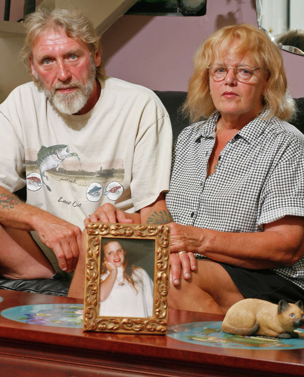 Randy and Sandy Ertman left Houston 8 years ago for a home near Lake Somerville, where they wait Friday afternoon May 12, 2006, to attend the execution next week for Sean O'Brien, convicted in the murder of their daughter Jennifer Ertman. O'Brien is the first of the Black and White Gang to face the death penalty. Besides O'Brien, four others were convicted and given a death sentence in the murders of then 14 year-old Ertman and Elizabeth Pena, then 16. A then 14 year-old received life in prison for his part in the murders, and the two 17 year-olds had their death sentence commuted to life in prison, after the Supreme Court rejected death sentences for underage offenders. (Houston Chronicle/Ben DeSoto)