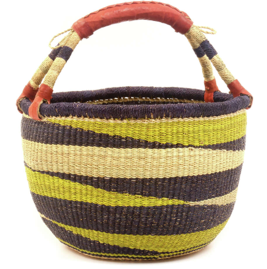 Craftsmen in Africa weave by hand these textile-rich baskets by hand, making each one unique. The leather-reinforced handles give these Ghana Golba Market baskets extra holding power. 8 inches across. $16.50. http://www.basketsfromafrica.com/ Photo: Baskets Of Africa.com / Baskets Of Africa / ONLINE_YES