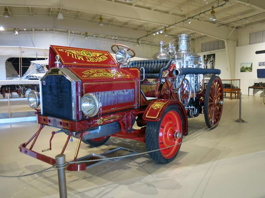 Museum exhibit: 1904 steam-powered pump engine with a 1918 American LaFrance tractor.