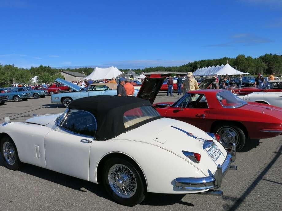 Front to rear: 1958 Jaguar XK150 ($56,100) and 1967 Chevrolet Corvette ($74,250.)