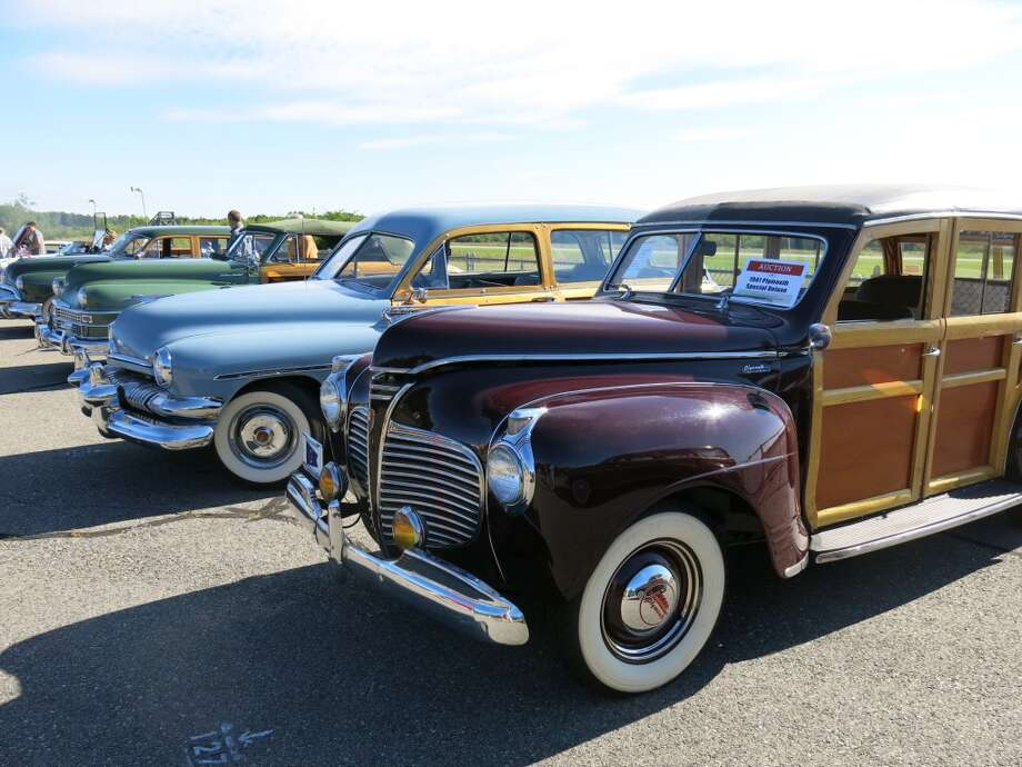 Front to rear: 1941 Plymouth Special Deluxe (passed); and 1951 Mercury station wagon ($66,000).