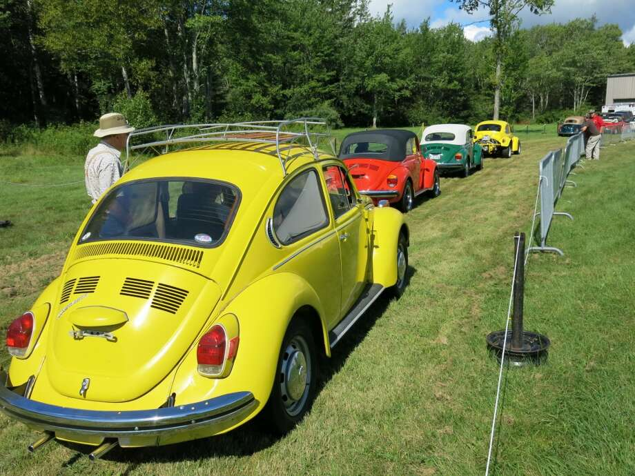 Volkswagens wait to be auctioned off. A 1979 convertible sold for $11,000.