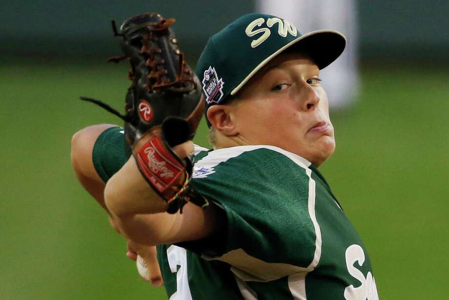 Pearland pitcher Walter Maeker III delivers during the first inning of an elimination baseball game against Chicago at the Little League World Series tournament in South Williamsport, Pa., Tuesday, Aug. 19, 2014. (AP Photo/Gene J. Puskar) Photo: Gene J. Puskar, Associated Press / AP