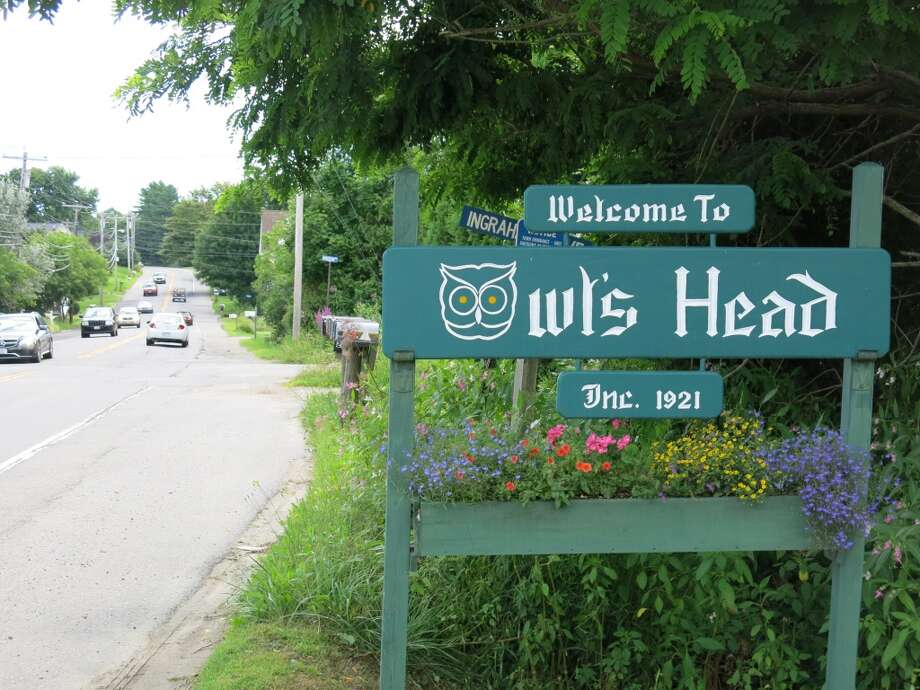 "Entrance to the Maine town of Owl's Head (or Owls Head), site of the annual Owls Head Transportation Museum auction. (Selling prices for all cars include a 10 percent buyer's premium. About one third of the 160 cars on the auction results list were described as ""passed,"" which means they may not have sold on the auction block, but could have been sold in a private transaction later on. Or they simply might not have sold.  (All photos by Michael Taylor.)"