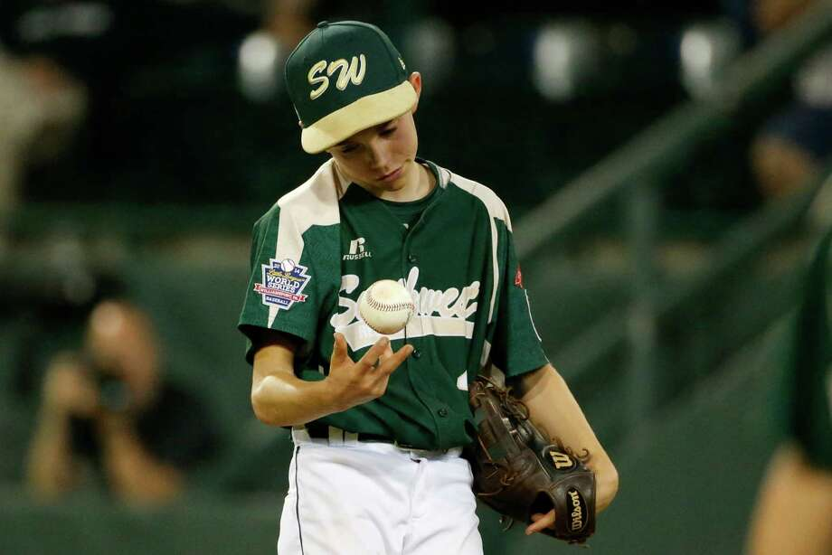 Pearland pitcher Bryce Laird waits for a visit from his manager in the fifth inning of an elimination baseball game against Chicago at the Little League World Series tournament in South Williamsport, Pa., Tuesday, Aug. 19, 2014. (AP Photo/Gene J. Puskar) Photo: Gene J. Puskar, Associated Press / AP