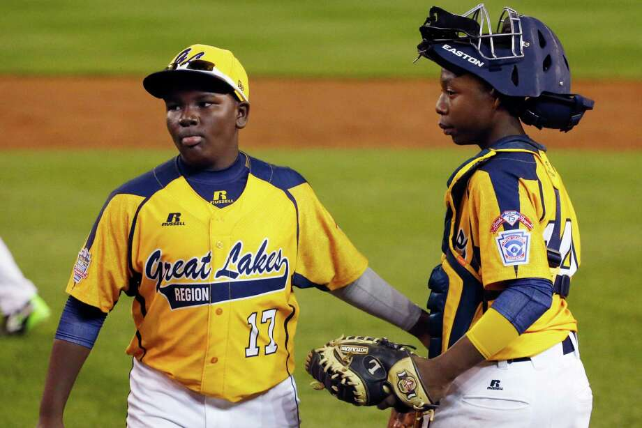 Chicago players Joshua Houston (17) and catcher Brandon Green celebrate a 6-1 win over Pearland in an elimination baseball game at the Little League World Series tournament in South Williamsport, Pa., Tuesday, Aug. 19, 2014. (AP Photo/Gene J. Puskar) Photo: Gene J. Puskar, Associated Press / AP