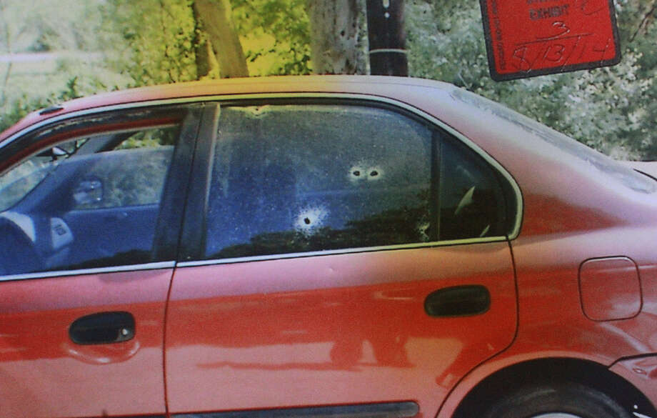 An exhibit in the murder trial of Simon Rene Garcia shows bullet holes in a car window. Garcia was given 30 years for his involvement in the shooting death of Samuel Douglas Wass, 32, in 2012. Photo: John Davenport / San Antonio Express-News / ©San Antonio Express-News/John Davenport
