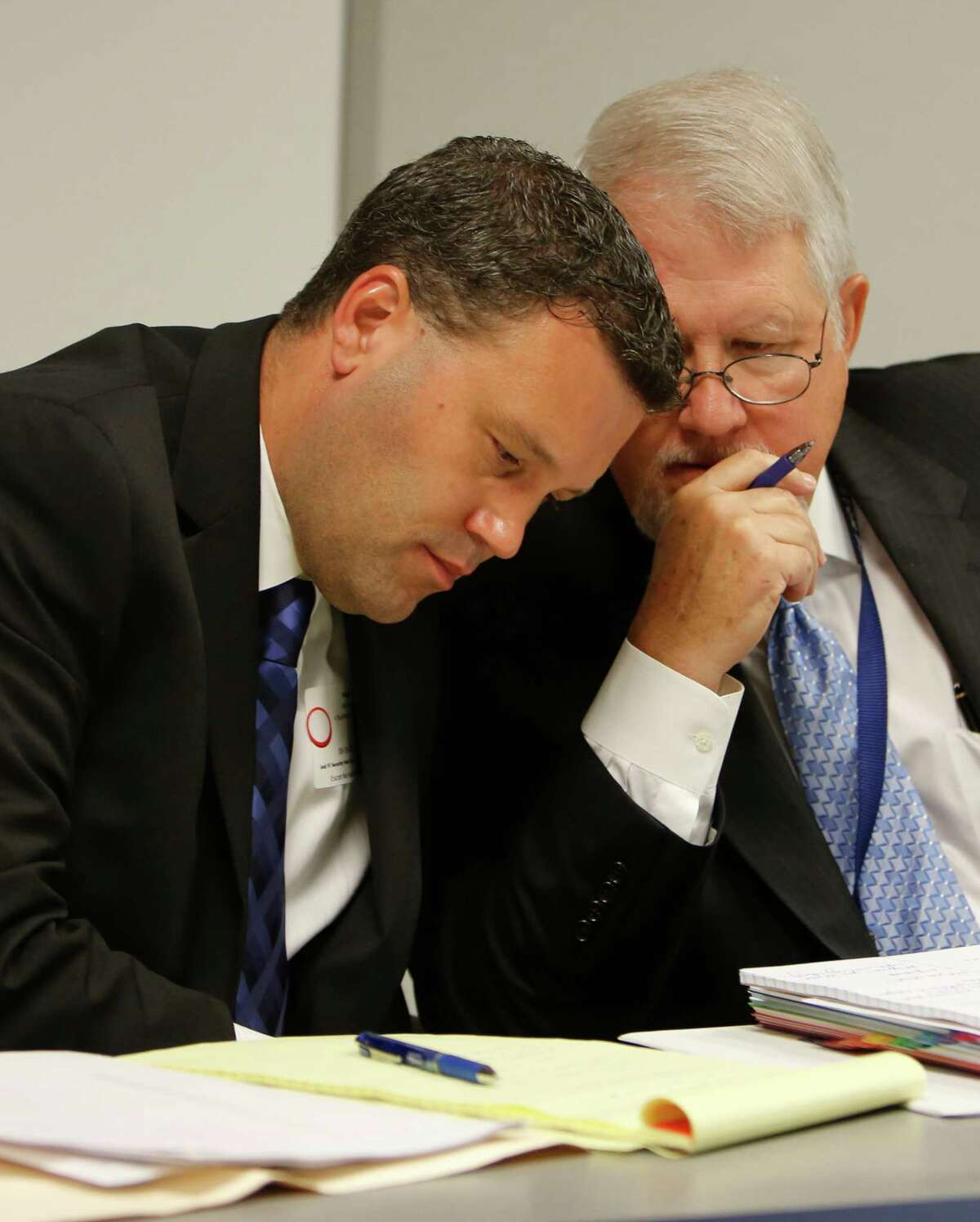 Ryan Chandler, left, confers with Robert Armbruster, staff counsel at the Houston Police Officers' Union.