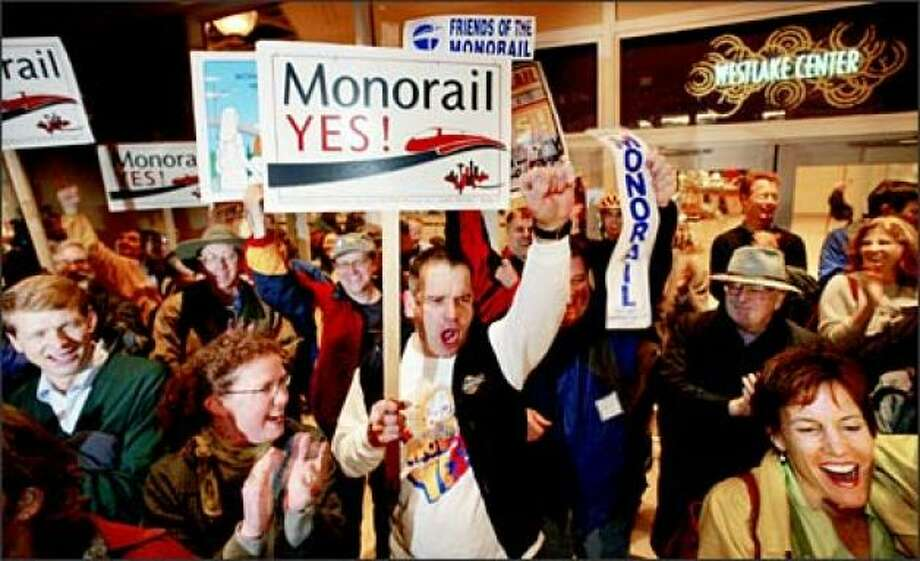 "The backers of a real Seattle monorail are annoying and dreamers and … but also attractive in their grit. We voted for it and vote for it and it imploded and skidded off the rail and now we're looking at another bout of mononucleosis.   The Seattle Times says:  ""Get ready for Monorail, the Sequel. Seattle voters will decide in November whether to fund planning for an elevated line between Ballard and West Seattle — some nine years after an earlier monorail project imploded.""  Photo: Monorail supporters celebrate the measure's victory at a news conference at the Westlake Center monorail station in 2002. (Photo: Dan DeLong/Seattle Post-Intelligencer)"
